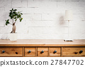 shelf with lamp and flower and white wall 27847702