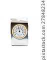 Gift thermometer in a metal case on a white. 27848234