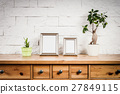 shelf with frames and flowers 27849115