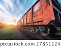 Railway station with cargo wagons in motion 27851124