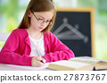 Smart little schoolgirl with pen and books 27873767