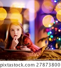 Cute little girl writing a letter to Santa  27873800
