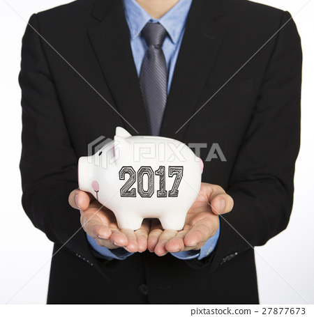 Man holding a piggy bank 27877673