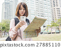 woman  look searching direction on location map 27885110