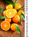 Beautiful fresh tangerines on the table 27888469