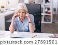 Upset aged businesswoman suffering from headache 27891501