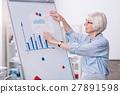 Positive senior businesswoman working on the 27891598