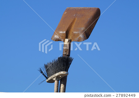 dustpan and brush with blue sky background 27892449