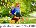 Kids picking vegetables on organic farm 27894980