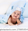 Baby in towel after bath in bed 27895054