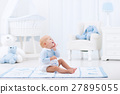Baby boy playing in bedroom 27895055