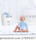Baby boy with bottle drinking milk or formula 27895057