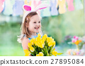 Little girl in bunny ears on Easter egg hunt 27895084