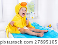 Baby in bath towel with tooth brush 27895105