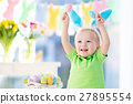 Baby with bunny ears on Easter egg hunt 27895554