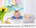 Child with bunny ears on Easter egg hunt 27895557