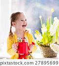 Little girl watering spring flowers 27895699