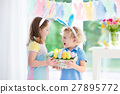 Kids with eggs basket on Easter egg hunt 27895772