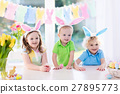 Kids with bunny ears on Easter egg hunt 27895773