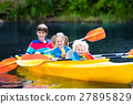 Kids kayaking on a river 27895829
