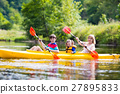 Family enjoying kayak ride on a river 27895833