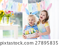 Kids with eggs basket on Easter egg hunt 27895835