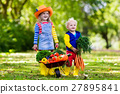 Kids picking vegetables on organic farm 27895841