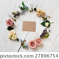 Empty greeting card and flowers circle on white 27896754