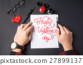 male hands writing a Valentine's day card 27899137