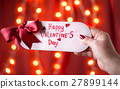 Hand holding Happy Valentines day card 27899144