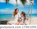Mother with child having fun swinging on beach 27901095