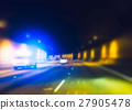 police car with lighting while  running in tunnel. 27905478