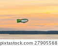 airship over the sea at sunset. 27905568