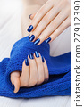 manicure with ablue knitted scarf 27912390
