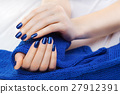 manicure with ablue knitted scarf 27912391