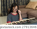 Cute silly young girl making funny faces, 27913646