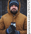 Beard man with hot drink in thermos cup in winter 27915757
