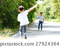 Two boy run in the park 27924364