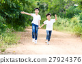Two boy run in the park 27924376