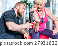 senior woman working out with dumbbells  27931832