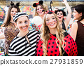Boy and girl dresses as ladybird and prisoner 27931859