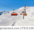 Chair ski lift with orange bubble shelter on sunny 27932106