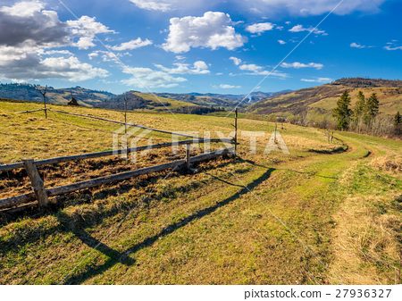 wooden fence on the hillside 27936327