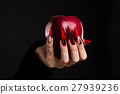 Hands with scary nails manicure holding red apple 27939236