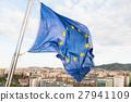 EU flag fluttering by wind above Barcelona 27941109
