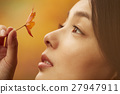 A woman enjoying autumn leaves 27947911