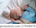 Unrecognizable mother holding newborn baby son 27948670
