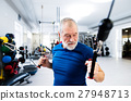 Fit senior man in gym working out with weights. 27948713