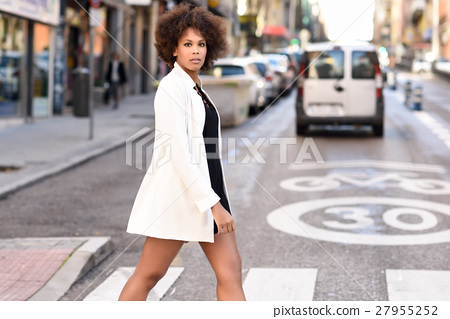 Young black woman with afro hairstyle standing in urban backgrou 27955252