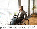 Disabled senior woman in wheelchair at home in 27959476